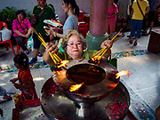 15 FEBRUARY 2018 - BANGKOK, THAILAND: People pray during Tet observances at the Poh Teck Tung Shrine in Bangkok's Chinatown. Lunar New Year, also called Tet or Chinese New Year, is 16 February this year. The coming year will be the Year of the Dog. Thailand has a large Chinese community and Lunar New Year is widely celebrated in Thailand, especially in Bangkok and large cities with significant Chinese communities.     PHOTO BY JACK KURTZ