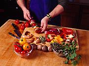 Steve Lacroix preparing shish kebab for grilling, kitchen at Winterlake Lodge, Finger Lake, Alaska.      MR