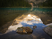 Low-angle view of beautiful, remote Lake O'Hara and Seven Veils Falls in the background, in Yoho National Park, near Field, British Columbia, Canada