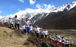 April 25, 2017 - Rasuwa, Nepal - Athletes run in the 2nd TAAN International Langtang Marathon at Kanjin monastery, with an altitude of 4000 meters in Rasuwa, Nepal. More than 100 National and International athletes participate in marathon organized by TAAN(Trekking Agencies' Association of Nepal) to mark the second anniversary devastating earthquake 2015 and to revive the tourism of Langtang valley. (Credit Image: © Sunil Sharma via ZUMA Wire)
