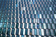 Modern architecture glazing - hexagonal coloured glass in shape of ice blocks at Harpa Concert Hall in capital city of Reykjavik, Iceland