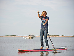 woman on a paddle board in Amagansett, NY