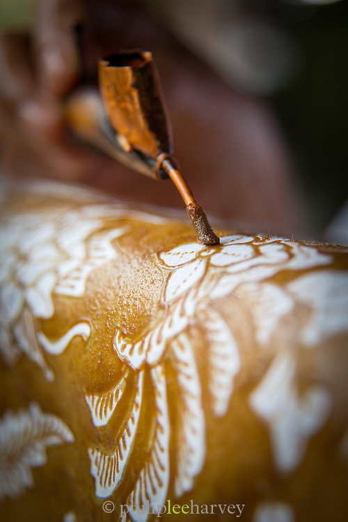 Detail of application of wax for the Batik process, wax resistant dyeing, Yogyakarta, Yogyakarta Special Region, Java, Indonesia, Southeast Asia