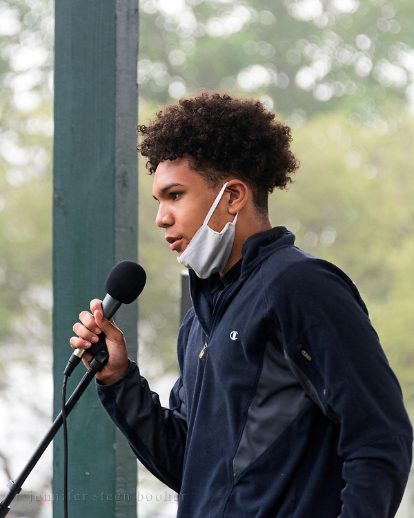 Bar Harbor, Maine, USA. 21 June, 2020. Charlie Parker, a student at Mount Desert Island High School addresses the crowd at the MDI March and Rally In Solidarity with Black Lives Matter. Mr. Parker is one of the march organizers.