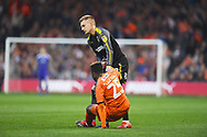 AFC Wimbledon player Joe Pigott helps Luton Towns player Kazenga LuaLua to his feet after a heavy tackle in which Pigott is shown a yellow cardduring the EFL Sky Bet League 1 match between Luton Town and AFC Wimbledon at Kenilworth Road, Luton, England on 23 April 2019.