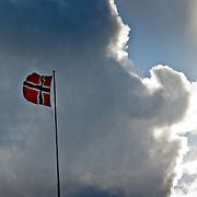 Three weeks aboard the Kong Harald. Hurtigruten, the Coastal Express. Bergen. The norwegian flag in Bergen.