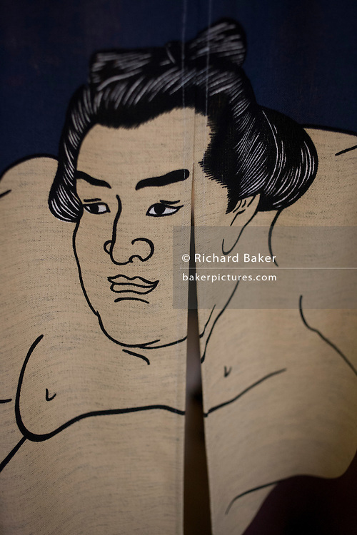 Detail of a Sumo wrestler, printed on a curtain in 'So', a sushi restaurant in central London.