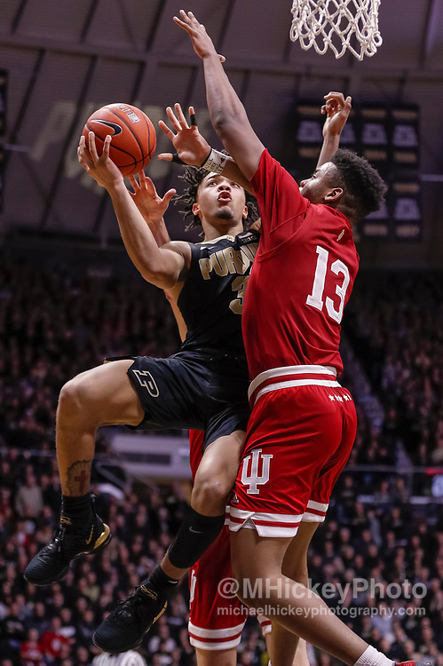 WEST LAFAYETTE, IN - JANUARY 19: Carsen Edwards #3 of the Purdue Boilermakers shoots the ball against Juwan Morgan #13 of the Indiana Hoosiers during the second half of the game at Mackey Arena on January 19, 2019 in West Lafayette, Indiana. (Photo by Michael Hickey/Getty Images) *** Local Caption *** Carsen Edwards; Juwan Morgan