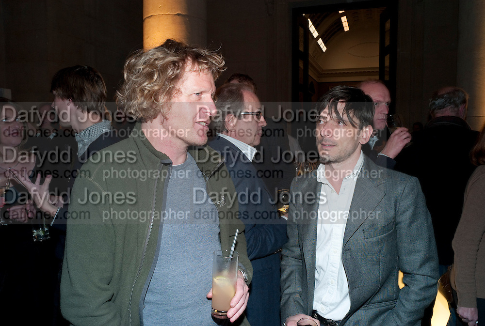 GRAYSON PERRY; JEREMY DELLER, TOUR OF THE TATE ARCHIVE, Archive 40 Reception. 40th Anniversary of the Tate archive. Tate Britain. Millbank. London. 25 October 2010. -DO NOT ARCHIVE-© Copyright Photograph by Dafydd Jones. 248 Clapham Rd. London SW9 0PZ. Tel 0207 820 0771. www.dafjones.com.