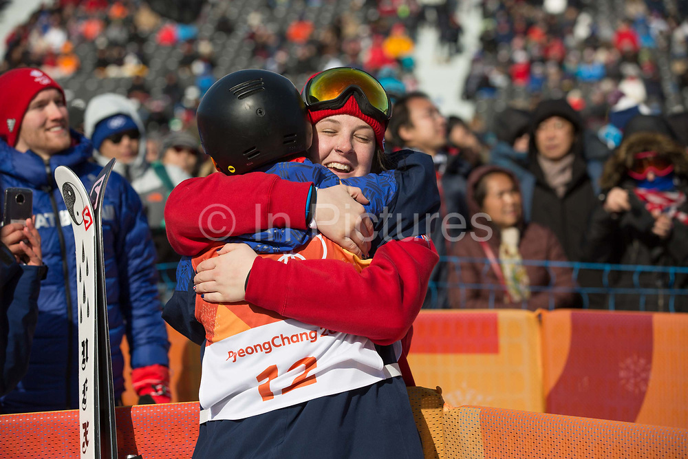 Isabel Atkin hugs fellow team mate, Molly Summerhayes after winning bronze at the womens ski slopestyle contest at the Pyeongchang Winter Olympics on 17th February 2018 at Phoenix Snow Park in South Korea