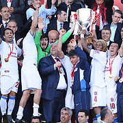 Jubilant Trabzonspor coach Senol GUNES (L), Alan Carlos Gomes Da COSTA (2ndL), Rigobert Song BAHANAG (2ndR), Umut BULUT (R) lifting up the cup at the ceremony during their after the Turkey Cup final match Trabzonspor between Fenerbahce at the GAP Arena Stadium at Urfa Turkey on wednesday, 05 May 2010. Photo by TURKPIX