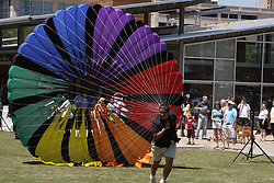 Stock photo of a man running with a large parachute