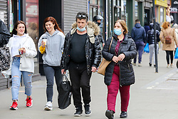 © Licensed to London News Pictures. 23/03/2021. London, UK. Shoppers in Wood Green, north London on the anniversary of the first Covid-19 lockdown in the UK. The next key date for restrictions easing is Monday 29 March 2021, when the 'Stay at Home' guidance will be dropped. Photo credit: Dinendra Haria/LNP