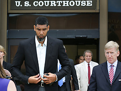 June 28, 2017 - San Antonio, Texas, U.S.- Retired Spurs player TIM DUNCAN left, leaves the John H. Wood Jr. Federal Courthouse with his lawyers after the sentencing of his former financial advisor Charles Banks (Credit Image: © San Antonio Express-News via ZUMA Wire)