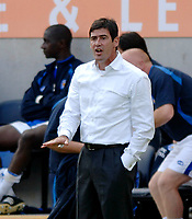 Photo: Henry Browne.<br /> Leicester City v Luton. Coca Cola Championship.<br /> 27/08/2005.<br /> Luton manager Mike Newell calms his players down.