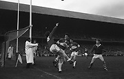 GAA All Ireland Minor Football Final Cork v. Loais 24th September 1967 Croke Park.<br /><br />Cork Forward T. O'Brien (no.15) jumps for the ball on the line but fails to prevent it going over the end line *** Local Caption *** It is important to note that under the COPYRIGHT AND RELATED RIGHTS ACT 2000 the copyright of these photographs are the property of the photographer and they cannot be copied, scanned, reproduced or electronically stored in any form whatsoever without the written permission of the photographer