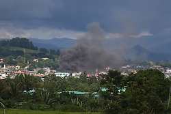 May 28, 2017 - Marawi, Philippines - Smoke rises as houses burn in Marawi City, southern Philippines.  Thousands of residents already left their homes houses due to clashers between government troops and the Maute militant group, in southern Philippines May 27, 2017. (Credit Image: © Linus Guardian Escandor Ii via ZUMA Wire)