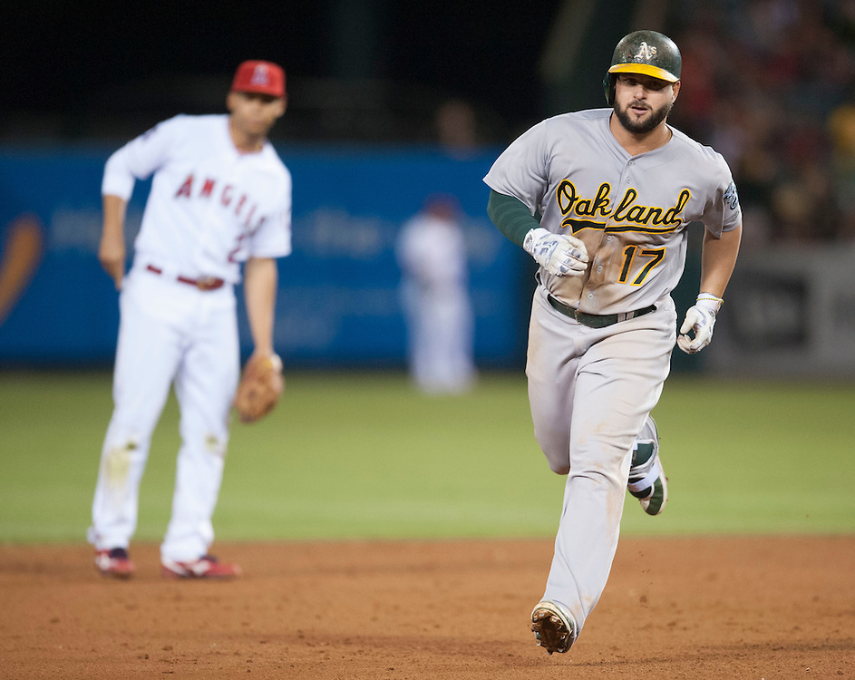 The Athletics' Yonder Alonso rounds the bases after hitting a two-run home run off of Angels'  reliever JC Ramirez in the eight  inning of the Angels' 5-4 victory over the Oakland Athletics at Angel Stadium on Tuesday.<br /> <br /> ///ADDITIONAL INFO:   <br /> <br /> angels.0803.kjs  ---  Photo by KEVIN SULLIVAN / Orange County Register  -- 8/2/16<br /> <br /> The Los Angeles Angels take on the Oakland Athletics at Angel Stadium.