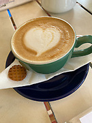 Cup of Cappuccino with a heart created on the surface with the cream foam