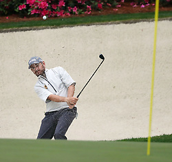 April 7, 2018 - Augusta, GA, USA - Louis Oosthuizen hits out of a trap on the 13th hole during the third round of the Masters Tournament on Saturday, April 7, 2018, at Augusta National Golf Club in Augusta, Ga. (Credit Image: © Curtis Compton/TNS via ZUMA Wire)