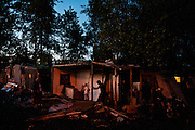 A family demolishes their home in the Belville camp in New Belgrade on the eve of the camp's destruction.