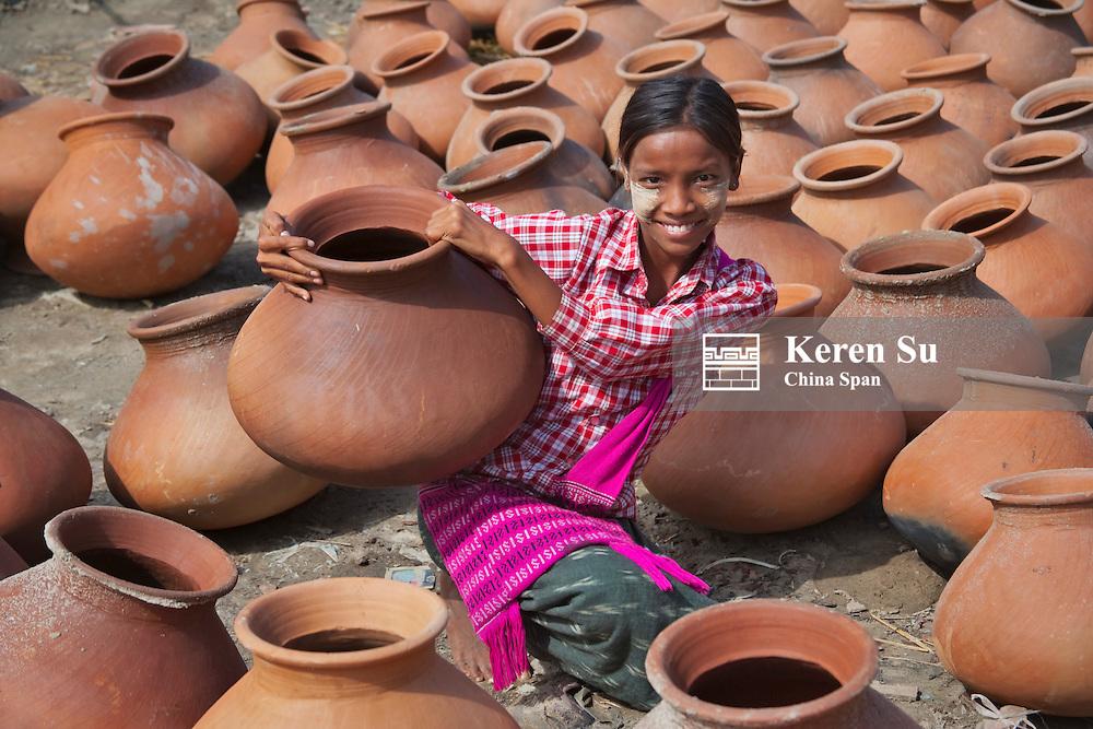 Girl with pottery jars, Mandalay, Myanmar