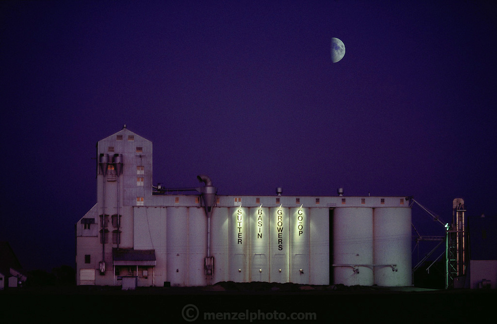 Rice: rice silo at night with half moon near Yuba City, California, USA.