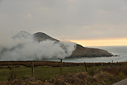 26-2-2013: Gorse fires rage accross a mountain overlooking Cooscrome Bay outside Cahersiveen in County Kerry on Tuesday. The last day for buring fires is March 1st..Picture by Don MacMonagle