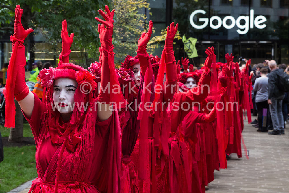 London, UK. 16 October, 2019. Extinction Rebellion's Red Brigade joins the International Rebellion Autumn Uprising 'No Social Media in a Dead Society' protest outside the headquarters of Google against the US company's role in 'enabling the spread of systematic disinformation on climate change and the ecological crisis'.