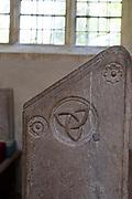 Interior of Saint Nicholas chapel, Gipping, Suffolk, England, UK fifteenth century benches Tryell knot family emblem