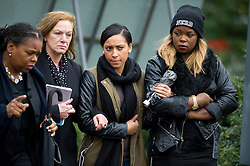 © London News Pictures. 19/09/2013. London, UK. Family and friends of Mark Duggan at the scene where Mark Duggan was shot dead by armed police in an incident that sparked the 2011 London Riots. The family attended a visit by the Jury to the scene of the incident as part of an ongoing inquest into the death of Mark Duggan. Photo credit: Ben Cawthra/LNP