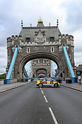 "Police and London Fire Brigades are responding to an incident in Tower Bridge of London, on Friday, June 19, 2020. ""Somebody is alleged to be willing to jump off the Bridge,"" said a member of LFB without giving any further details. (Photo/ Vudi Xhymshiti)"