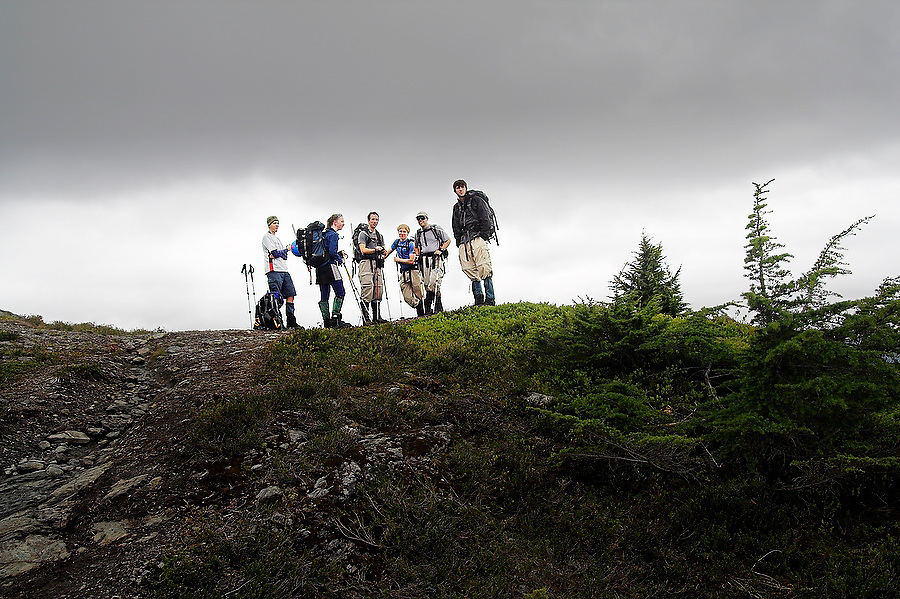 A group of hikers stand together on the Yellow Aster Butte trail, Mount Baker Wilderness, Washington.