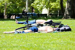 © Licensed to London News Pictures. 14/05/2019. London, UK. Men sunbathing in London's St James's Park on a warm and sunny day in the capital. Temperatures are set to reach 19C in the capital and potentially higher in the some parts of the UK. Photo credit: Dinendra Haria/LNP