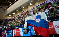 Fans of Slovenia celebrates after the basketball match at 1st Round of Eurobasket 2009 in Group C between Slovenia and Great Britain, on September 07, 2009 in Arena Torwar, Warsaw, Poland. (Photo by Vid Ponikvar / Sportida)
