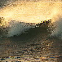 Surf at sunset in Honolua Bay, Maui.
