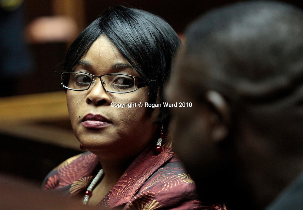 Sheryl Cwele talks with her co-accused Frank Nabolisa in the dock of the Pietermaritzburg High Court, 12 October, 2010. Cwele, wife of the Minister of State Security Siyabonga Cwele and Nabolisa, a Nigerian national, are currently on trial for dealing or conspiring to deal in drugs, drug trafficking and recruiting drug mules . © Rogan Ward 2010. © Rogan Ward 2010