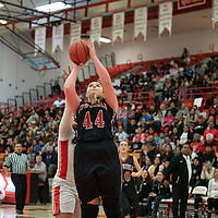Cliff Cowgirls Jamie Hicks (44) gets a jump shot off in the paint against a Pine Hill Warriors defender during the NMAA State Tournament. The Cowgirls defeated the Warriors 51-40 at Bernalillo High School in Bernalillo Wednesday morning.