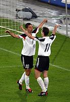 Die Deutschen Kevin Kuranyj und Miroslav Klose jubeln ueber das Tor zum 1:0.<br />© Daniela Frutiger/EQ Images