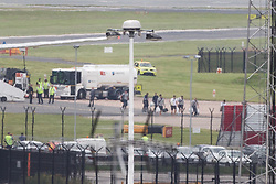 © Licensed to London News Pictures . 25/06/2014 . Manchester , UK . Members of the team disembark . The plane carrying the England football team lands at Manchester Airport this afternoon (25th June 2014) . Photo credit : Joel Goodman/LNP