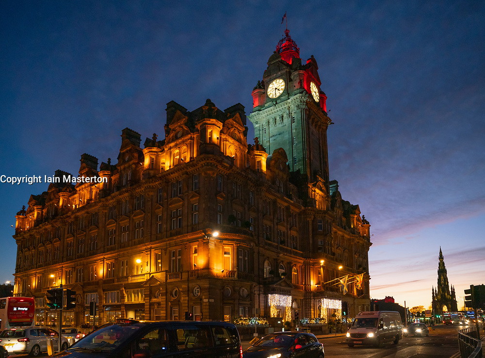 Edinburgh, Scotland, UK. 24 December 2020. Beautiful Christmas Eve and Brexit Deal sunset over Edinburgh viewed in front of the Balmoral Hotel and long Princes Street. Iain Masterton/Alamy Live News.