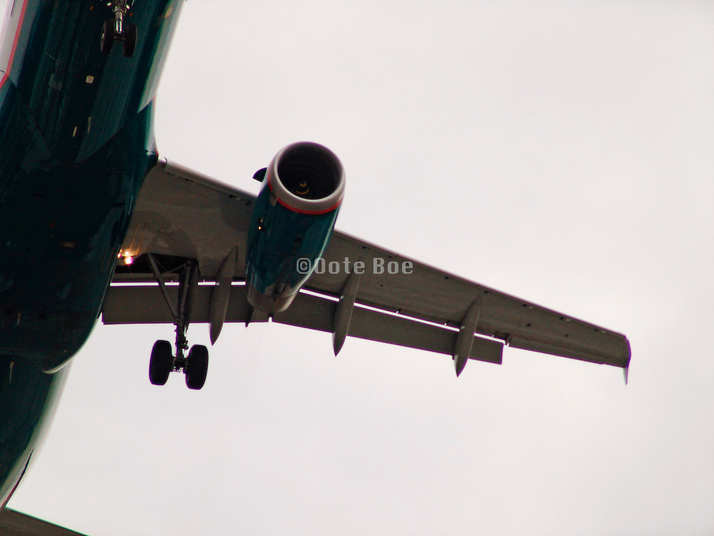 Close up of the wing of a commercial airplane while in the air.