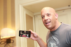 March 31, 2017 - Hollywood, California, U.S. - VIN DIESEL promotes 'The Fate of the Furious' Mark Sinclair (born July 18, 1967), better known by his stage name Vin Diesel, is an American actor, producer, director and screenwriter. He is well known for his portrayals of Dominic Toretto in The Fast and the Furious film series, Richard B. Riddick in The Chronicles of Riddick series and Xander Cage in xXx series. He was also a producer on sequels in these franchises. Diesel has also starred in films such as The Pacifier (2005) and Find Me Guilty (2006). His voice acting work includes The Iron Giant (1999), the video game spin-offs from The Chronicles of Riddick franchise, and Guardians of the Galaxy (2014). He wrote, directed, produced, and starred in a short film titled Multi-Facial and the feature-length drama film Strays. He is the founder of the production companies One Race Films, Racetrack Records and Tigon Studios. Fast & Furious 10 (2021), Fast & Furious 9 (2019), Avengers: Infinity War (2018), Guardians of the Galaxy Vol. 2 (2017), The Fate of the Furious (2017), Furia (2017). (Credit Image: © Armando Gallo via ZUMA Studio)