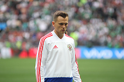 June 14, 2018 - Moscow, Russia - Russian Federation. Moscow. The Luzhniki Stadium. Match Opening of the World Cup 2018. Russia - Saudi Arabia. Solemn opening ceremony of the FIFA World Cup 2018. FIFA World Cup 2018. Player of the Russian national football team (in red).Fedor Smolov. (Credit Image: © face to face via ZUMA Press)