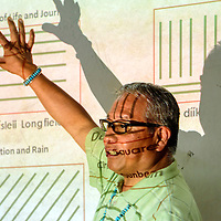 062515  Adron Gardner/Independent<br /> <br /> A projection overlays Emerson John as he breaks down different patterns of corn planting during Tsehootsoi Medical Center culture night at the St. Michaels Chapter House Thursday.