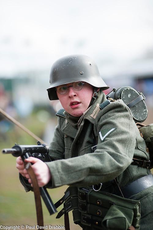 Reeactor portraying Gefrieter from panzer Grenadier Regiment Grossdeutschland using a blank firing MP3008 Sub Machine Gun.21 April  2013.Image © Paul David Drabble