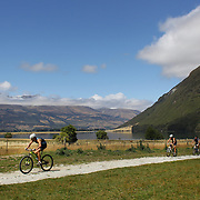 Competitors in action in the bike leg of the Paradise Triathlon and Duathlon series, Paradise, Glenorchy, South Island, New Zealand. 18th February 2012. Photo Tim Clayton