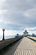 The ancient Victorian pier with timber decking on east shore of the Severn Estuary at Clevedon in Somerset