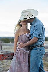 cowboy kissing a beautiful girl outdoors