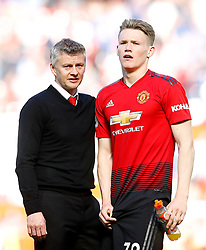 Manchester United manager Ole Gunnar Solskjaer (left) with Scott McTominay (right) after the final whistle after the Premier League match at Old Trafford, Manchester.